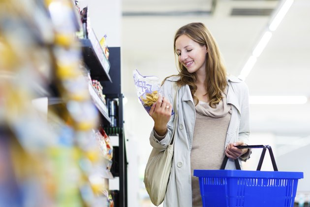 Beautiful young woman shopping in a grocery