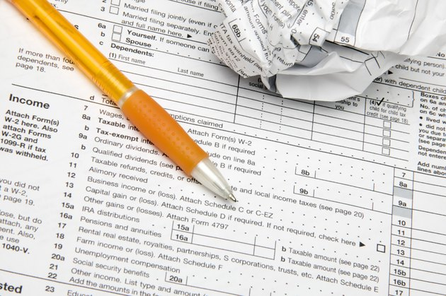 Tax forms with pen