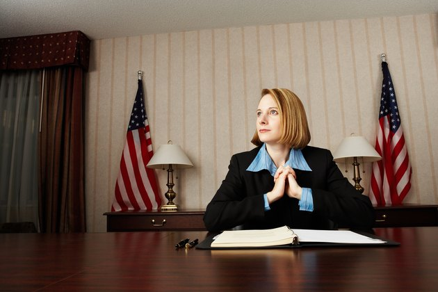 Pensive businesswoman at desk