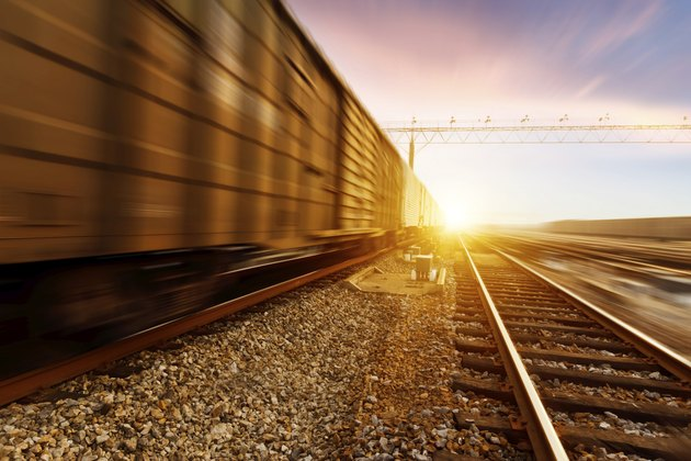 fast moving freight train, drawing out of the station