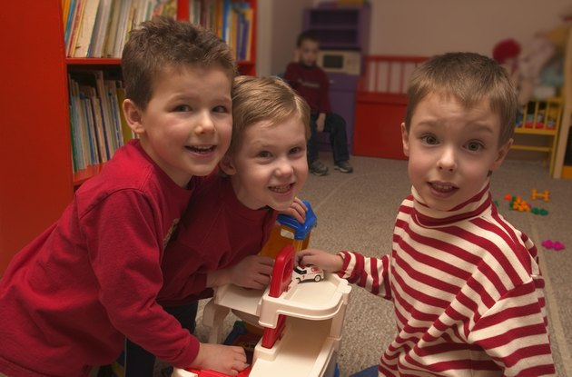 Three boys playing together at preschool