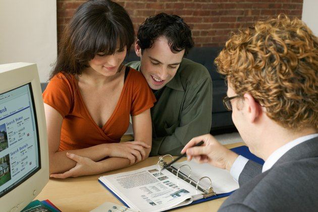 Couple with real estate broker