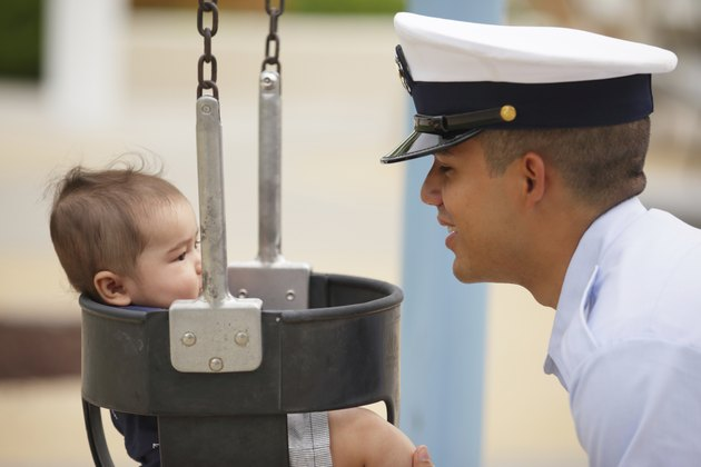 Stock image of a military man with his baby