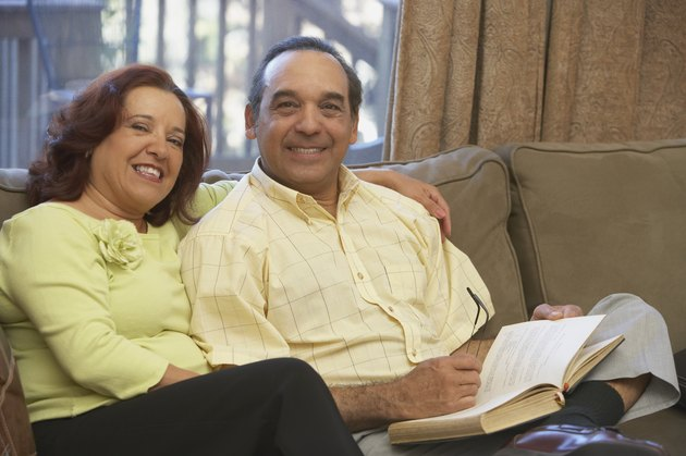 Portrait of a mature couple sitting together on the couch