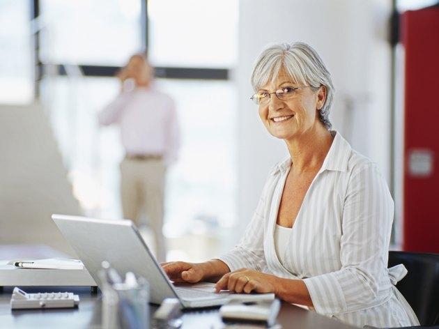 portrait of a mature woman using a laptop