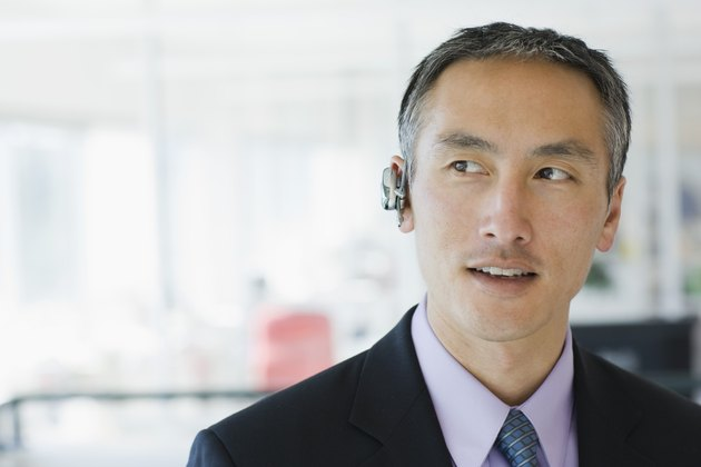Businessman wearing cell phone earpiece