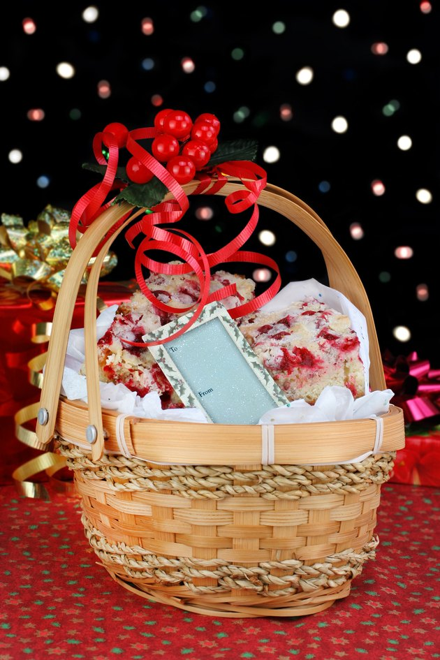 Christmas basket of cranberry bar cookies in front of colorful b