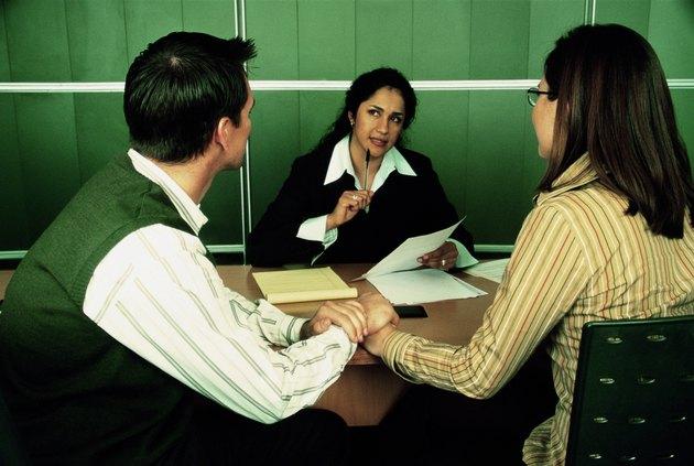 Businesswoman talking to couple