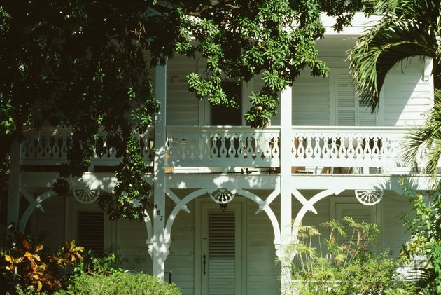Exterior of old-fashioned home with foliage, Florida