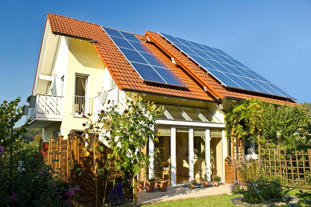 Solar panels at a house roof in late summer