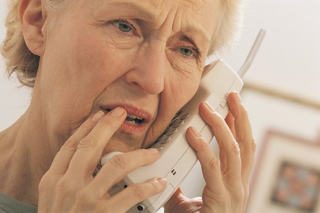 Worried woman on telephone