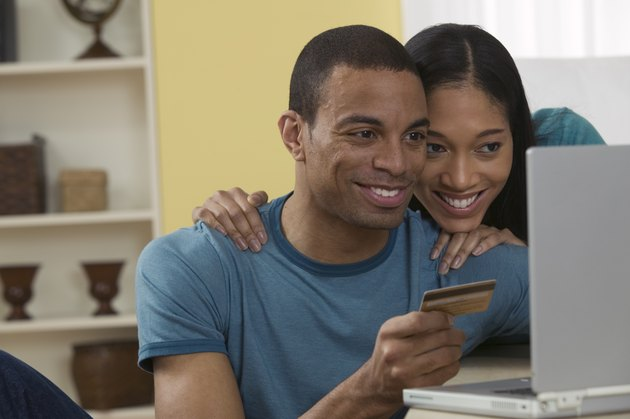 Couple with credit card on laptop
