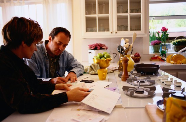 Couple Managing Their Finances in the Kitchen