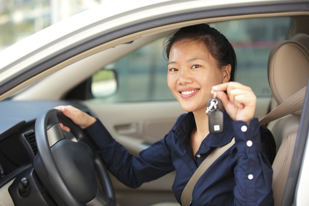 woman driver happy with her first car