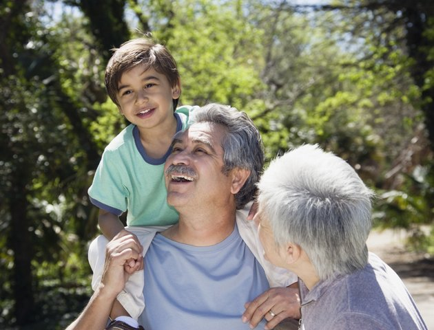Hispanic grandparents with grandson outdoors