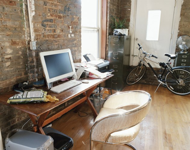PC, Desk and Bicycle Inside an Apartment