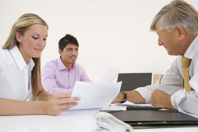 Couple with financial adviser