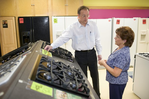 Salesman with woman in appliance store