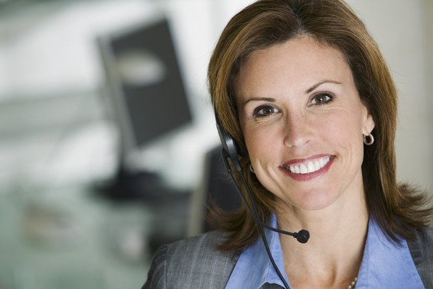 Smiling businesswoman with hands-free headet