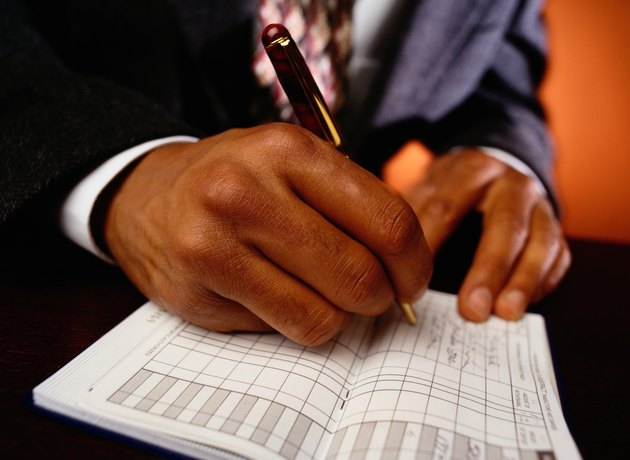Businessman Writing in Checkbook