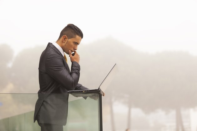 Modern businessman at the office balcony