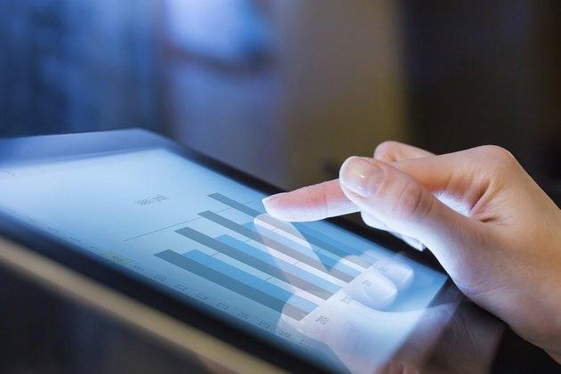Woman holding digital tablet, closeup