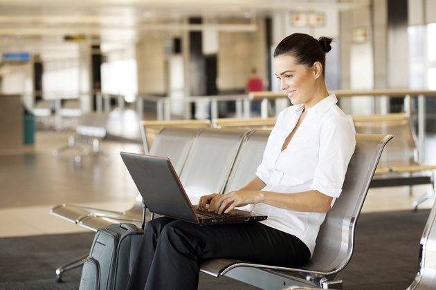 woman using laptop computer at airport