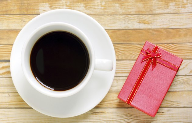 Cup of coffee with red present box