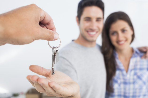 Man being given a house key