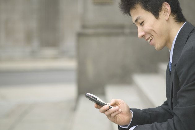 Mid adult businessman operating a mobile phone