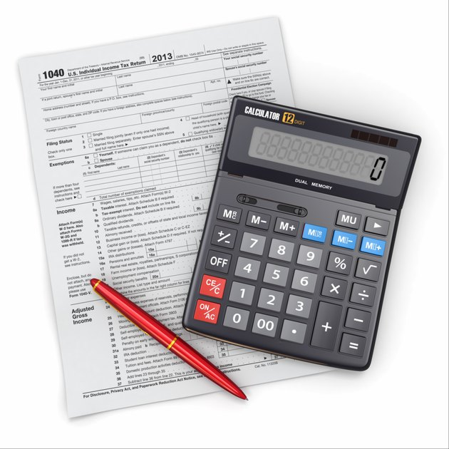 """Tax Return 1040, calculator and pencil on white background"""