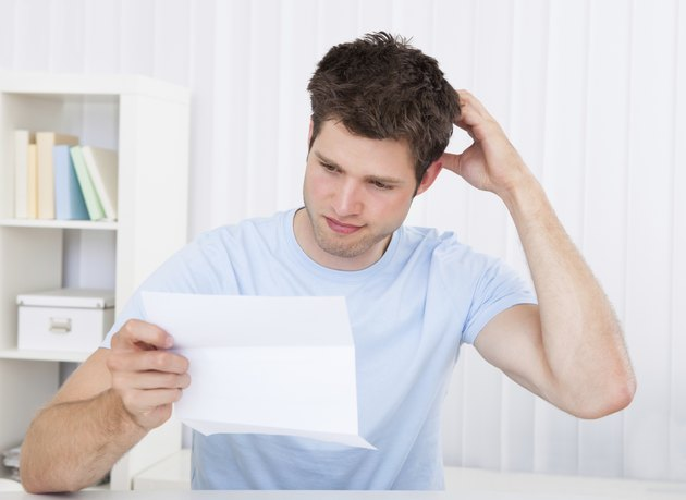 Confused Man Looking At Paper