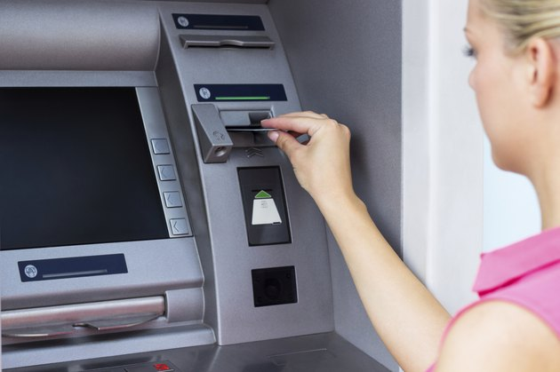 Young woman using a ATM
