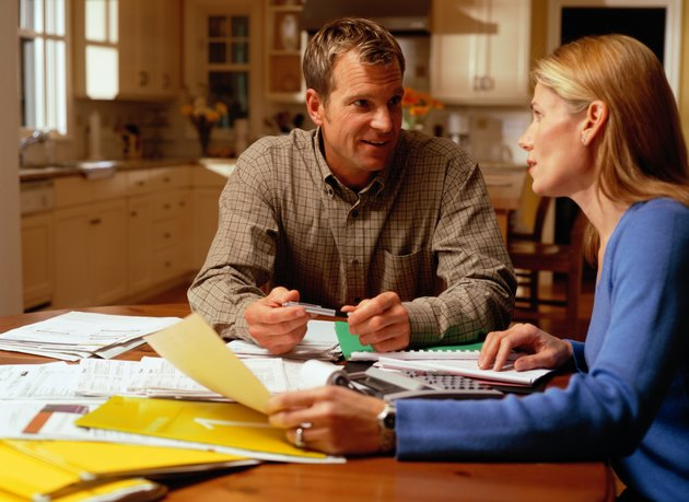 Man and Woman Balancing Accounts