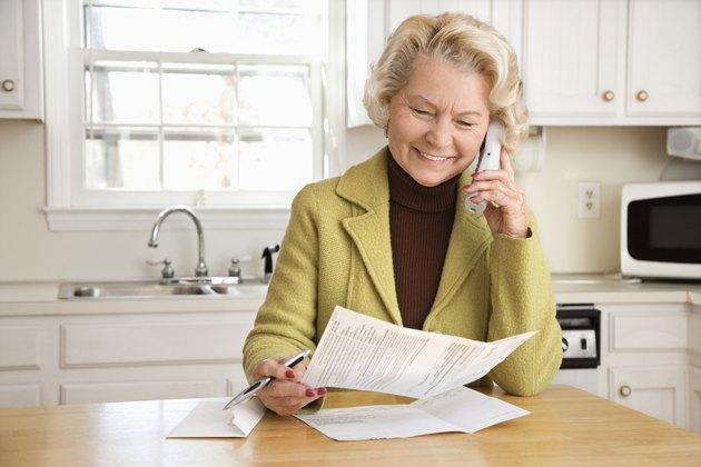 Senior woman smiling as she talks on cordless phone