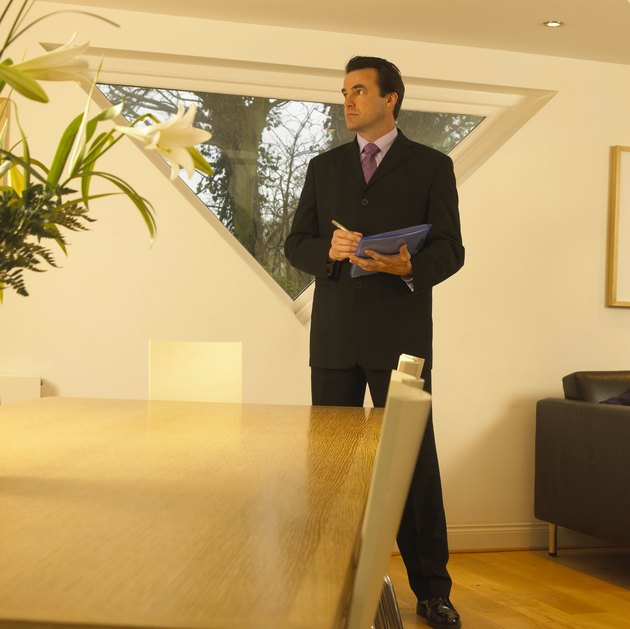 Man inspecting house