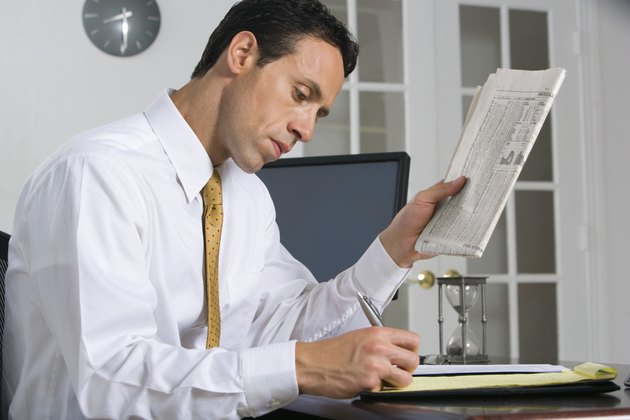 Businessman with newspaper
