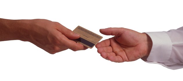 Hands with credit card