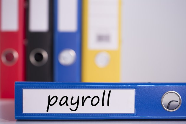 Payroll on blue business binder