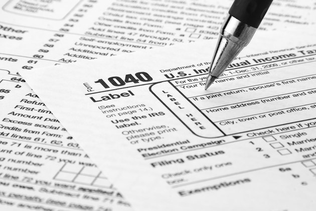 Tax Form 1040 being filled out
