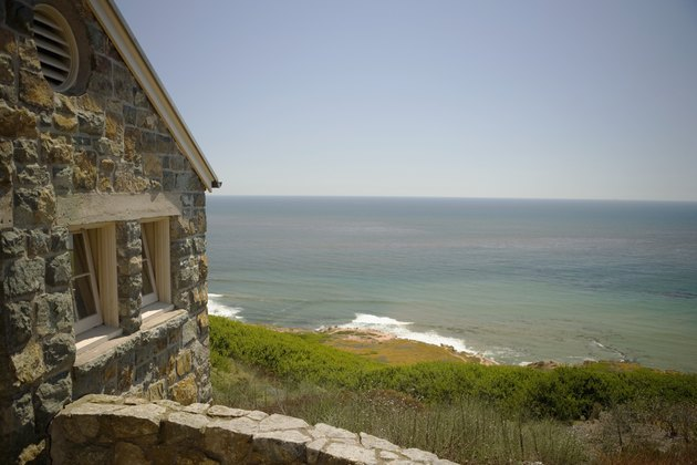 Side profile of a stone cottage on a waterfront, Pacific Ocean, San Diego, California, USA