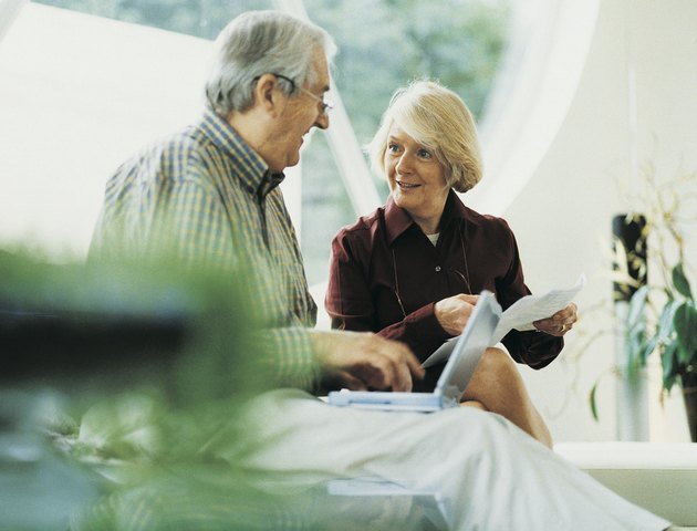 Mature Couple Working at Home
