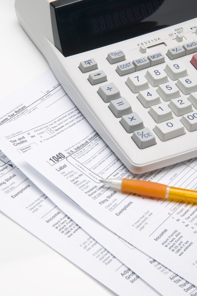 Adding machine, tax forms and pen