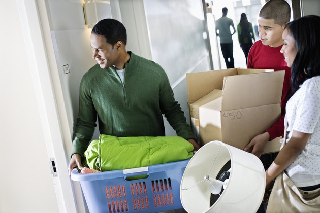 Father Helping Daughter Move into Dormitory