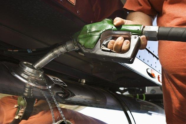 Trucker pumping gas