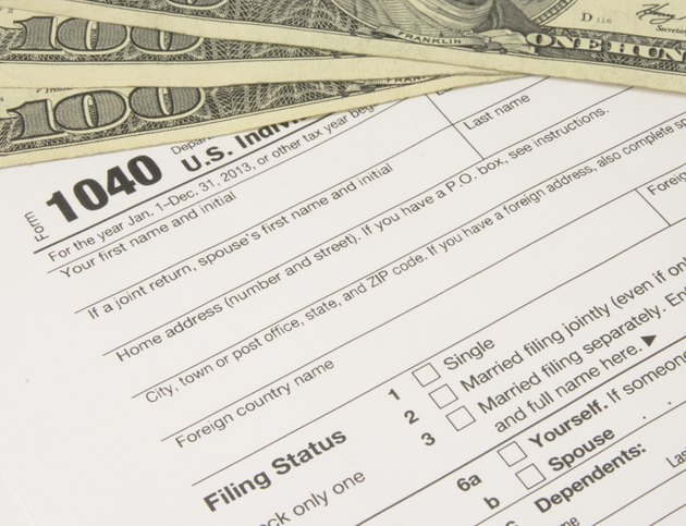 IRS Tax Form 1040 with Money