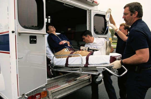 Putting Woman in Ambulance