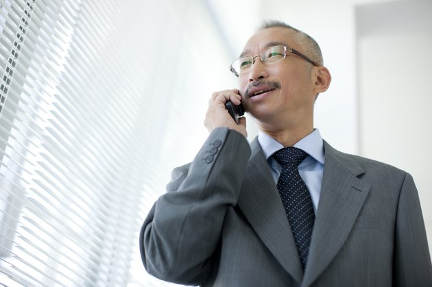 Businessman using mobile phone