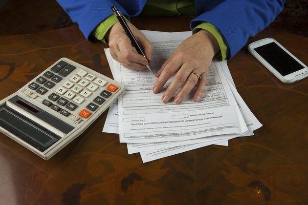Woman fills tax return