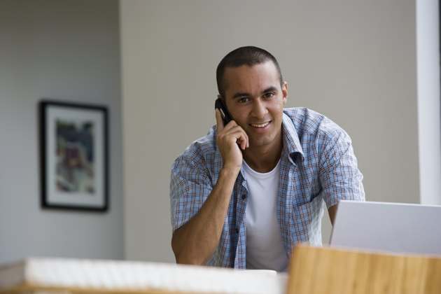 Young man talking on telephone